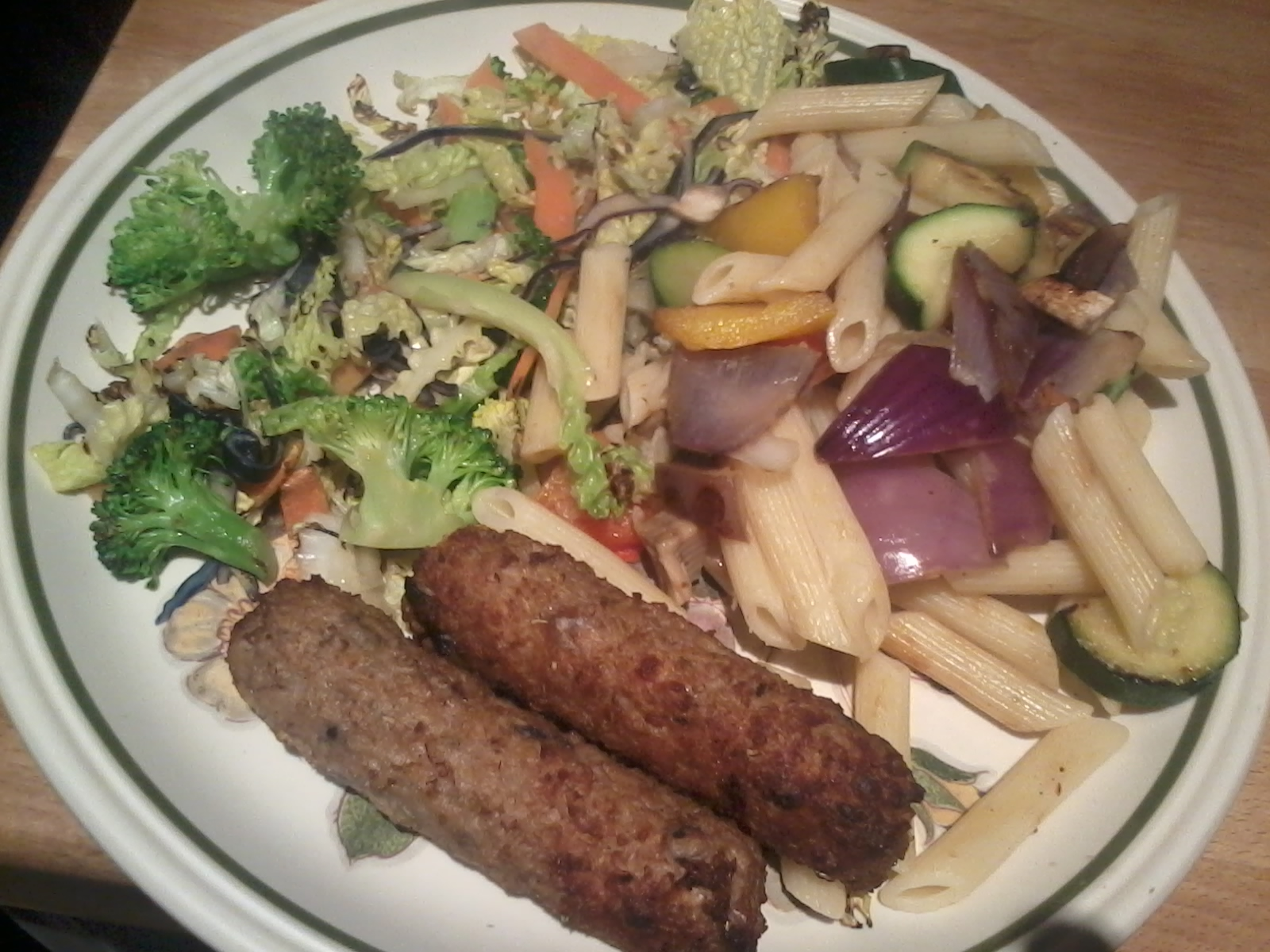 Rainbow pasta, stir fry veg and two lovely Linda Mccartney red onion and rosemary sausages.