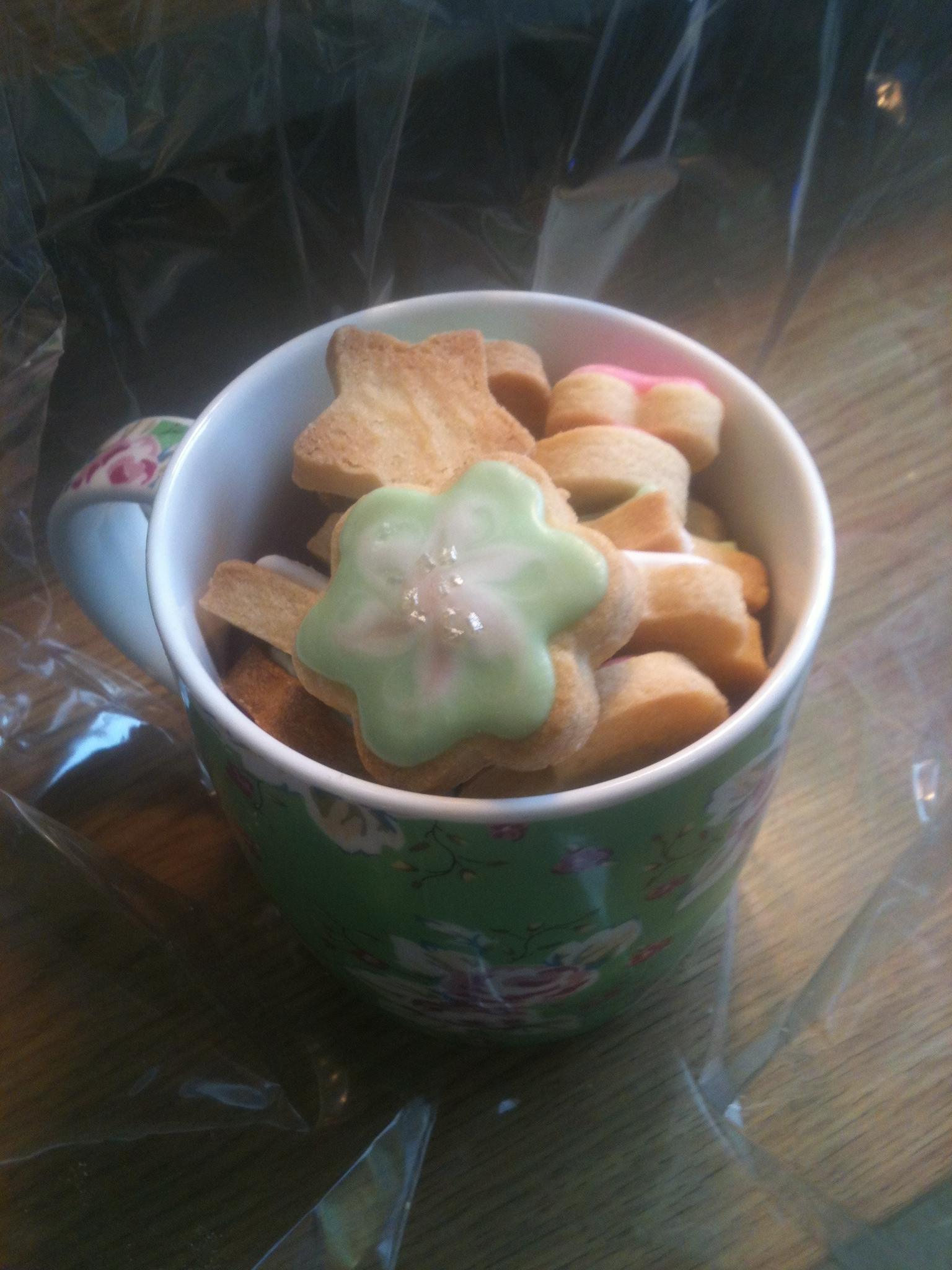 Handbaked and decorated biscuits in a gorgeous cup, all wrapped up and looking lovely