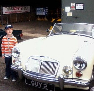My oldest, Kieran next to an absolutely fab classic car